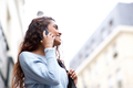 Side of young Indian woman talking with cellphone in city - PhotoDune Item for Sale