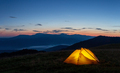 Orange luminous tent on the mountain in evening or early morning - PhotoDune Item for Sale
