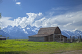 Old barn in a field under the Grand Teton mountains with dramatic clouds - PhotoDune Item for Sale