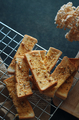 Close-up view of the garlic breadsticks on the cooling rack - PhotoDune Item for Sale