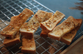 Close-up view of the garlic breadsticks on the colling rack - PhotoDune Item for Sale