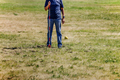 shot put referee in field of measurement result - PhotoDune Item for Sale