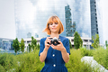 Attractive redhead woman taking photos in town - PhotoDune Item for Sale
