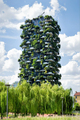 View of a Milan Vertical Forest apartment tower against blue sky - PhotoDune Item for Sale