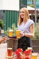 Happy friendly waitress serving pints of lager or beer - PhotoDune Item for Sale