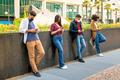 Line of friends ignoring each other to text on their mobiles - PhotoDune Item for Sale