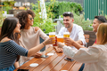 Group of friends celebrating at an open air restaurant - PhotoDune Item for Sale