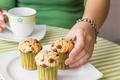 Nice girl hand taking chocolate chip muffin - PhotoDune Item for Sale