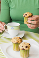 Nice girl hand taking chocolate chip muffin at breakfast - PhotoDune Item for Sale