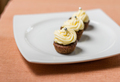 Chocolate cupcakes with silver sprinkles on top on white plate - PhotoDune Item for Sale