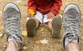 Sneakers front view of father sitting on field with his son - PhotoDune Item for Sale