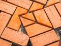 Orange brick paving stones in construction process - PhotoDune Item for Sale
