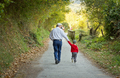 Grandfather and grandchild walking in nature path - PhotoDune Item for Sale