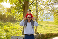 Grandfather holding grandchild on his shoulders - PhotoDune Item for Sale