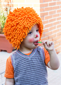 Clown child eating lollipop in a party - PhotoDune Item for Sale