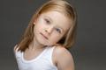 Portrait of lovely child in photo studio posing alone - PhotoDune Item for Sale