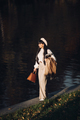 Picture of attractive woman goes for a walk near the river and thinks about something - PhotoDune Item for Sale