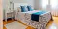 Double bedroom decorated with quilt and curtains - PhotoDune Item for Sale