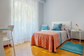 Bedroom decorated with quilt and curtains - PhotoDune Item for Sale