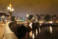 Bridge over the Amstel river at night in Amsterdam - PhotoDune Item for Sale