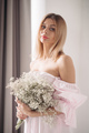 beautiful young girl in white dress holding a boquet of white flowers - PhotoDune Item for Sale