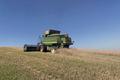 grain harvester harvesting wheat - PhotoDune Item for Sale