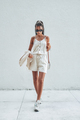 Trendy woman dressed in white summer clothing - PhotoDune Item for Sale