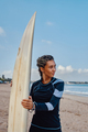 Woman with dreadlocks and surfboad on beach - PhotoDune Item for Sale