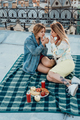 Two young girls on picnic on rooftop - PhotoDune Item for Sale