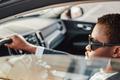 Serious african american businessman inside of car - PhotoDune Item for Sale