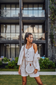 Attractive woman in bali posing against mansion - PhotoDune Item for Sale