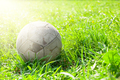 Old soccer ball on the green grass - PhotoDune Item for Sale