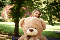 Young woman with teddy bear in the park. - PhotoDune Item for Sale