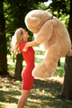 Young woman with teddy bear in the park - PhotoDune Item for Sale