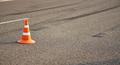 Orange traffic cone on the race track - PhotoDune Item for Sale