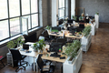 Group of desks with computer monitors standing along large windows - PhotoDune Item for Sale