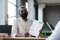 Young Muslim businessman in protective mask looking at colleague - PhotoDune Item for Sale