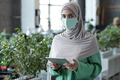 Young Muslim businesswoman with tablet looking at camera - PhotoDune Item for Sale