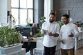 Two young Muslim businessmen preparing for presentation - PhotoDune Item for Sale