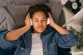 Teenage girl listening to relaxation music before sleep - PhotoDune Item for Sale