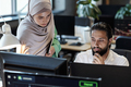 Young Muslim businessman and businesswoman working in front of computer - PhotoDune Item for Sale