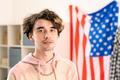 Teenage guy in pink hoodie standing in front of camera - PhotoDune Item for Sale