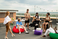Group of cheerful friends having rooftop party - PhotoDune Item for Sale
