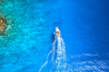 Aerial view of the speed boat in clear blue water at sunny day - PhotoDune Item for Sale