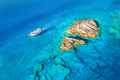 Aerial view of beautiful yacht on the sea and rocks at sunny day - PhotoDune Item for Sale