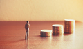 Miniature people looking future with stack coin about financial and money savings concept. - PhotoDune Item for Sale