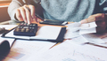 Man using calculator and calculate bills in home office. - PhotoDune Item for Sale
