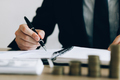 Investors are writing investment records and growth of mutual funds on the table at the office. - PhotoDune Item for Sale
