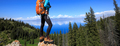 Successful woman backpacker hiking on forest mountain peak - PhotoDune Item for Sale