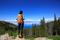 Young woman backpacker hiking on forest mountain peak - PhotoDune Item for Sale